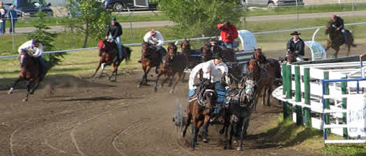 chuck wagon race in the final turn of the circuit